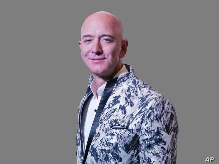 Jeff Bezos headshot, Amazon founder and CEO, graphic element on gray